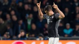 Bayern into Last 16 as Lewandowski downs PSV