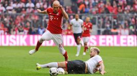 Bayern stumble, Dortmund win Borussia battle