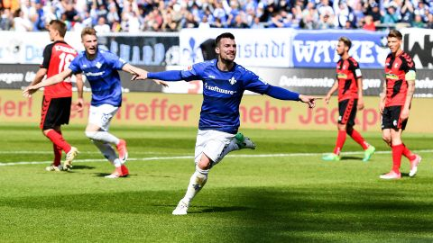 Darmstadt fight on with Freiburg win