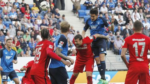 Hoffenheim beat Frankfurt to secure top-four berth