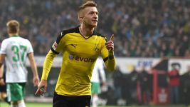 Dortmund keeping lid on title ambition