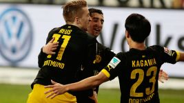 Dortmund cut gap but title-talk still taboo
