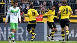 Dortmund rout Wolfsburg to keep title race alive