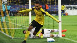 Dortmund down Benfica to reach quarter-finals