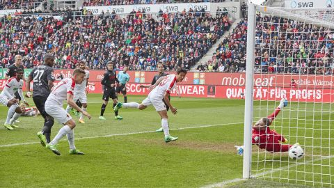 Spirited Augsburg down Cologne