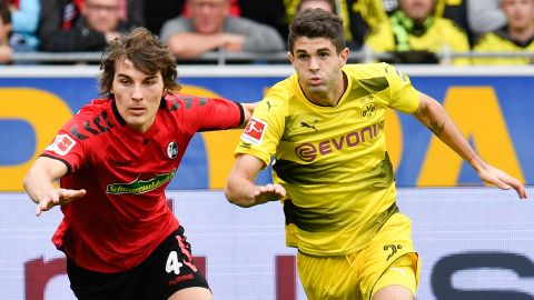 Dortmund held by ten-man Freiburg