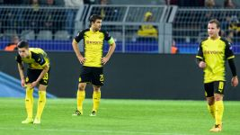 Dortmund knockout hopes hanging by thread