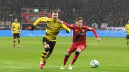 Ten-man Leverkusen hold Dortmund