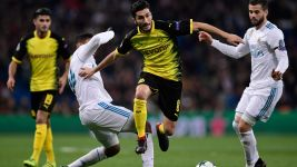 Dortmund into Europa League despite Real defeat