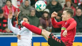 Leverkusen up to second despite draw in Freiburg