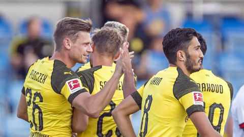 Dortmund pegged back late against Rennes
