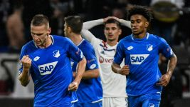 Ten-man Hoffenheim fight back in Lyon