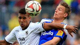 KIEL AND 1860 SHARE SPOILS IN PLAY-OFF FIRST LEG